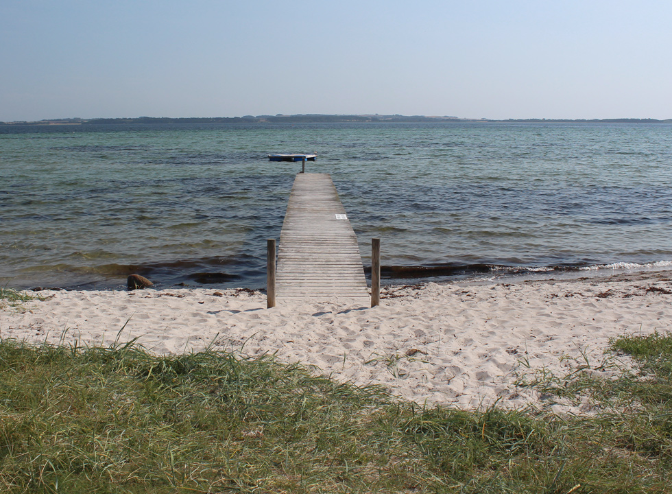 Bathing jetty by the sandy beach in the northern part of Skæring