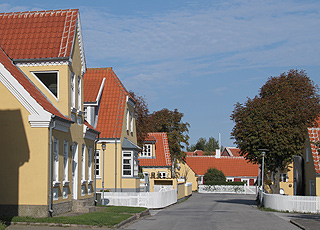 A typical street in Skagen Midtby with beautiful yellow Skagen houses