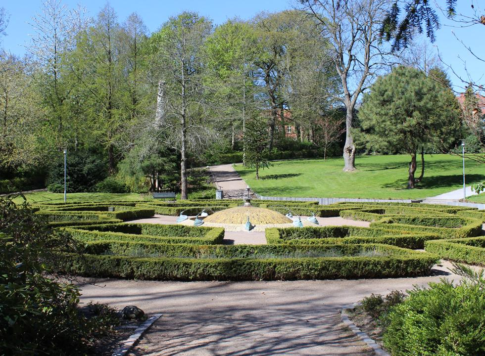 Fountain and beautifully clipped hedges in the centre of the park Anlægget in Skive