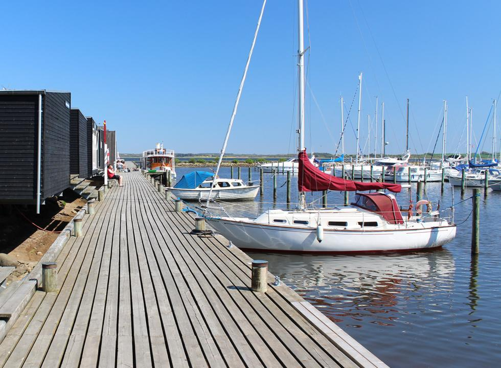 Wooden platform along the holiday apartments and the marina in the harbour of Skive