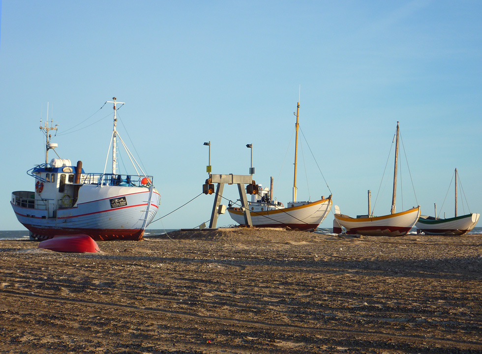 An early spring day with fishing vessels on the beach of Slettestrand