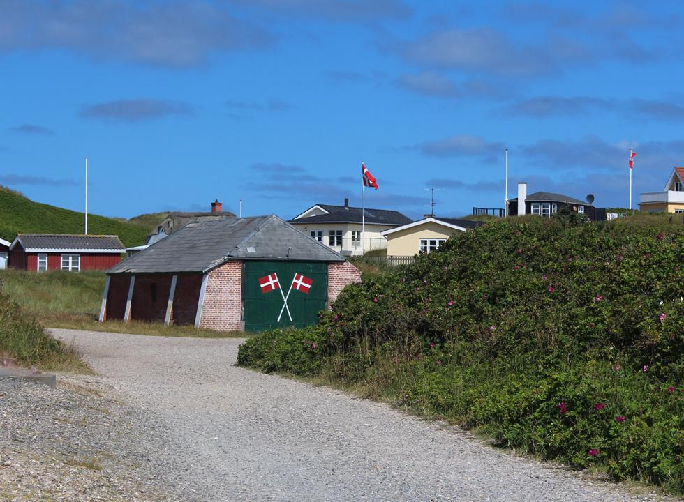 Rescue house, which is situated behind the high dunes of the beach, among the holiday homes of Sondervig