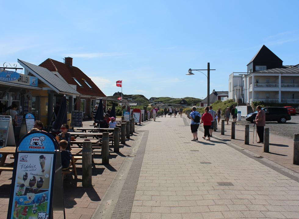 Pedestrian street with shops and eateries on the way towards the beach in Sondervig