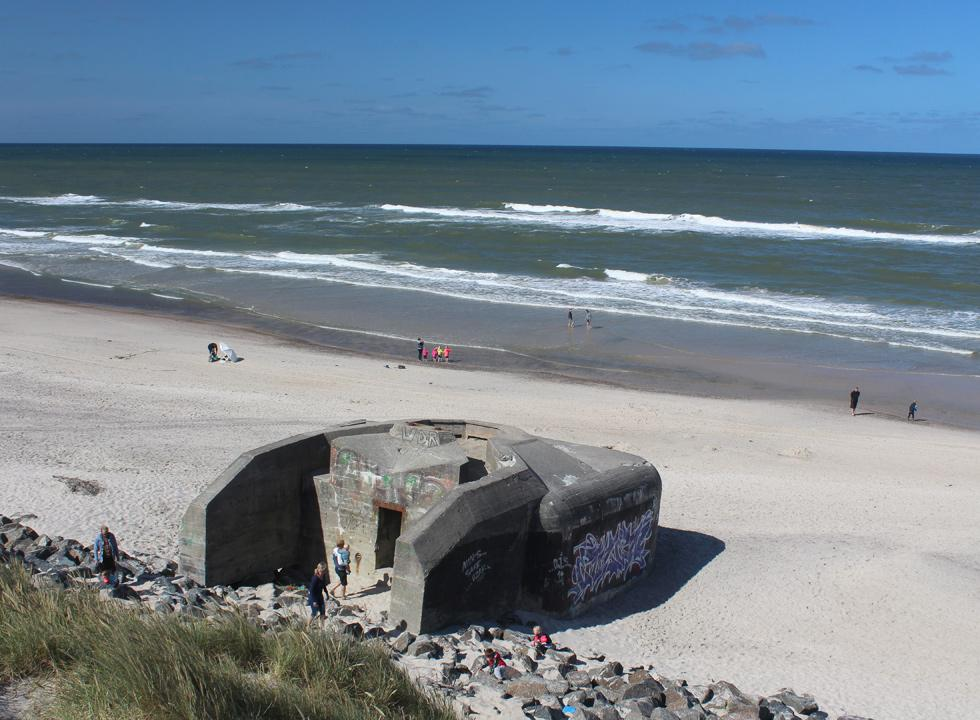 The many bunkers on the beach of Sondervig provide shelter and shade on hot days