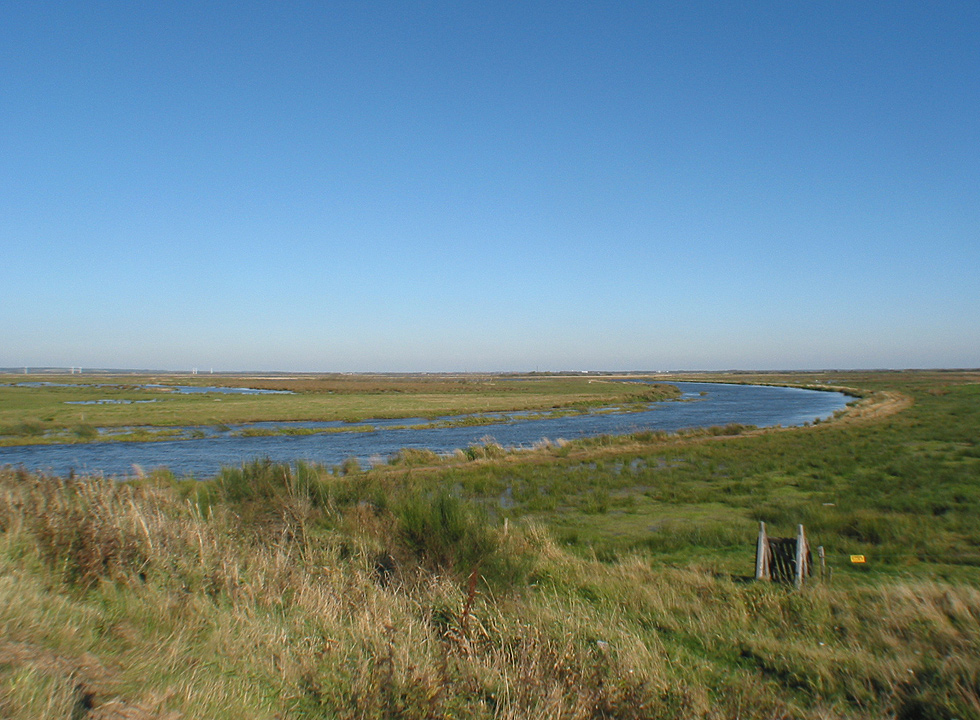The stream, Skjern Aa, winds through the landscape behind Stauning