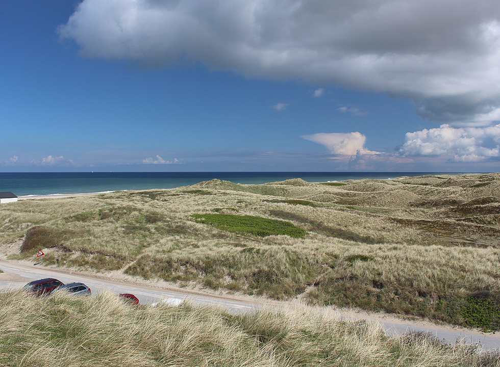 View of the dune landscape and the sea from the dune behind the beach of Stenbjerg