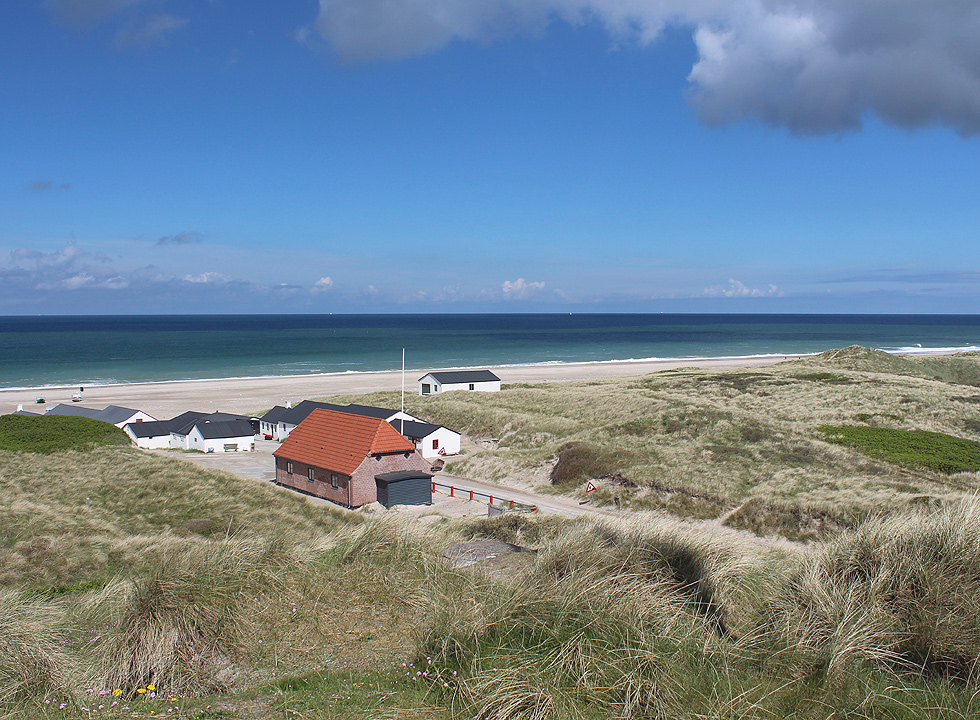 The rescue house, the fishing houses, the beach and the dunes in Stenbjerg
