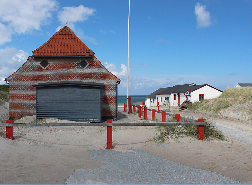 The rescue house and the white fishing houses by the beach of Stenbjerg