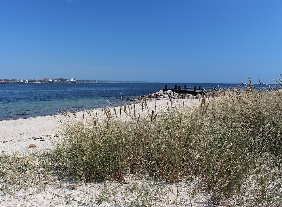 View of the beach towards Fredericia on the other side of The Little Belt from Strib Odde