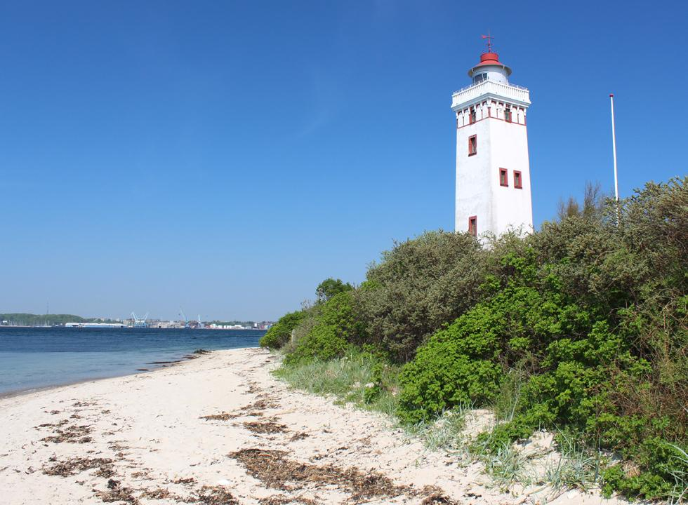 The beautiful white lighthouse, Strib Fyr, from the year 1900 on the tip of the headland, Strib Odde