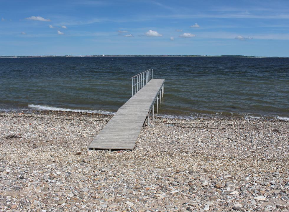 Clear bathing water by the bathing jetty in the holiday home area Sundby, Mors