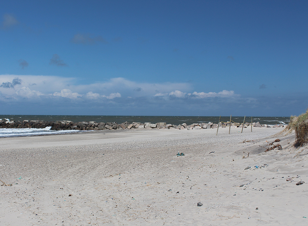 The lovely bathing beach with breakwater and high dunes in Thorsmindes
