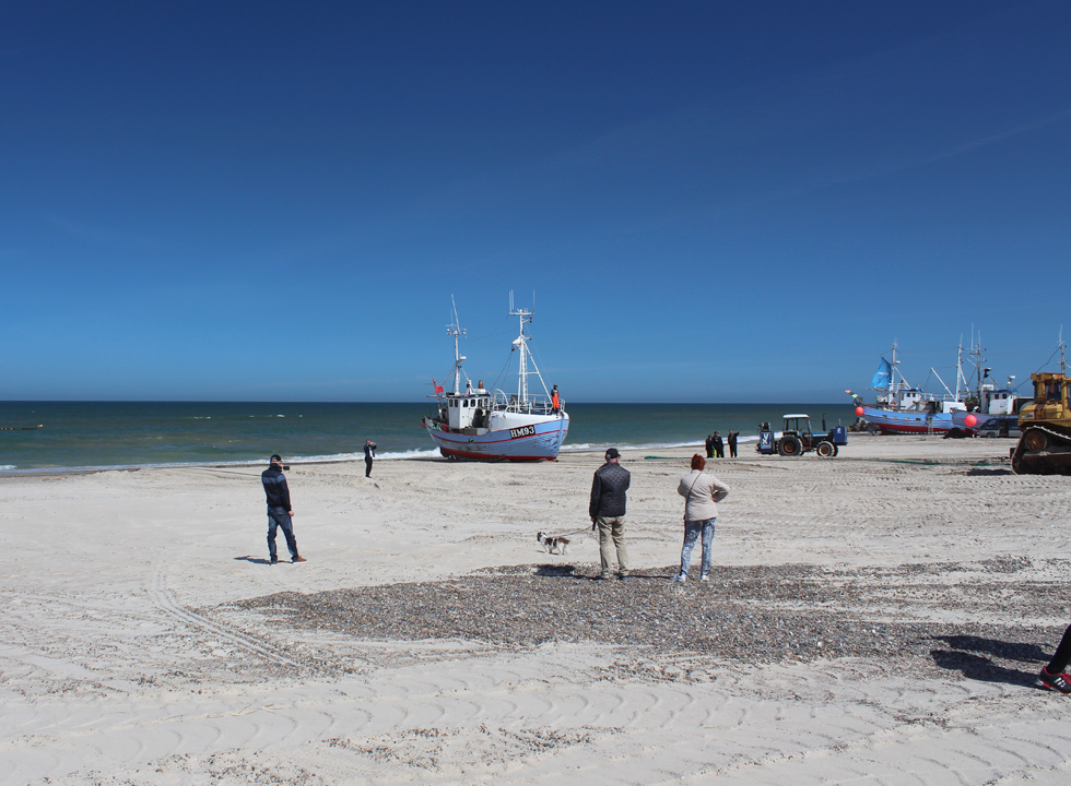 A fishing boat is pulled up on the beach in Thorup Strand