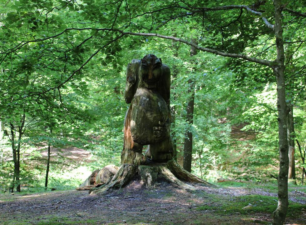 Interesting wooden figure near the pavilion Tolne Skovpavillon