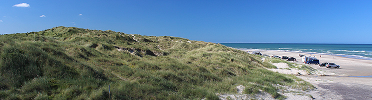 Lovely bathing beach and hilly dune landscape in Tornby