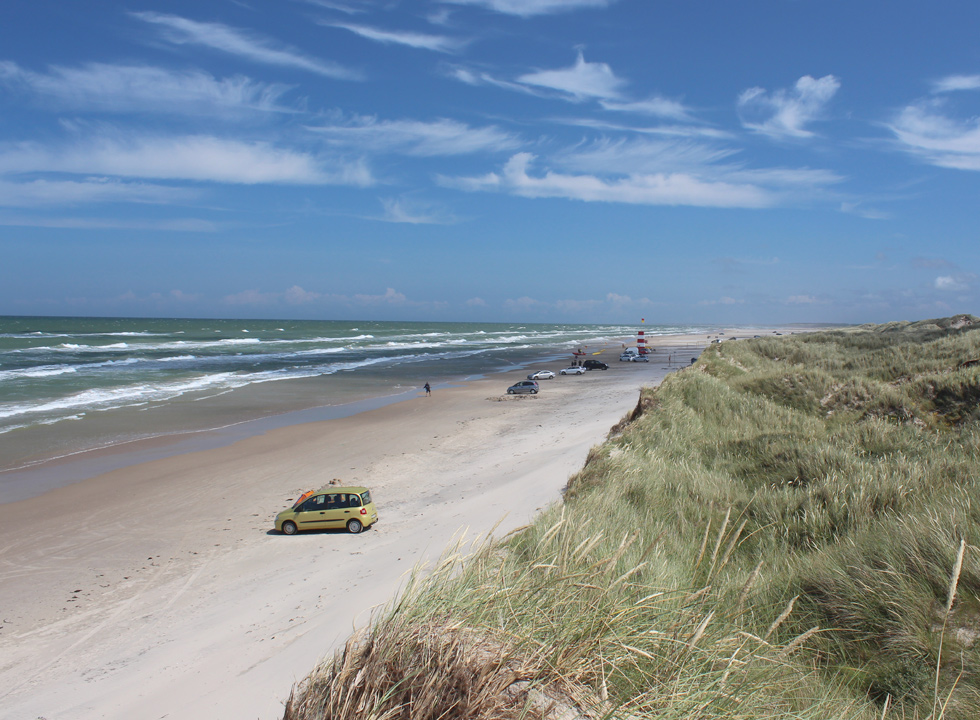 The northern part of the beach in Tversted with lifeguard tower and high dunes