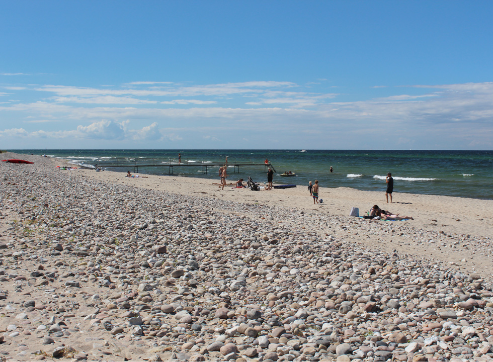 Lovely bathing beach with a bathing jetty and clear water in Udsholt Strand