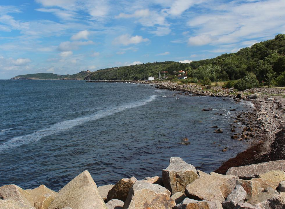 View form Vang Pier towards Vang and the castle ruin Hammershus