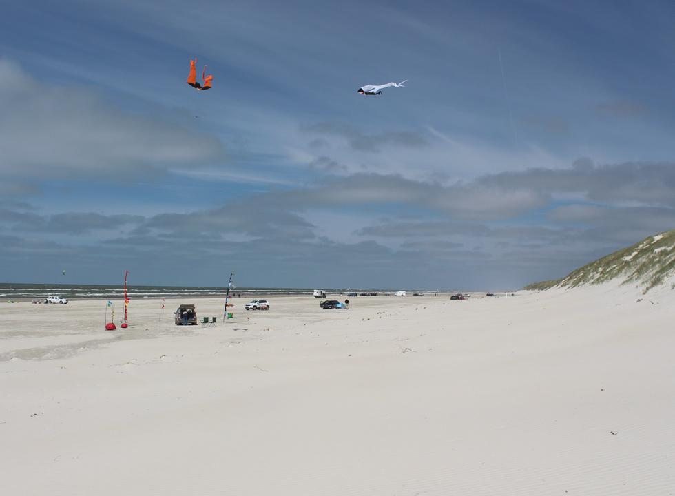 Kite flying on the wide, white and sandy beach in Vejers