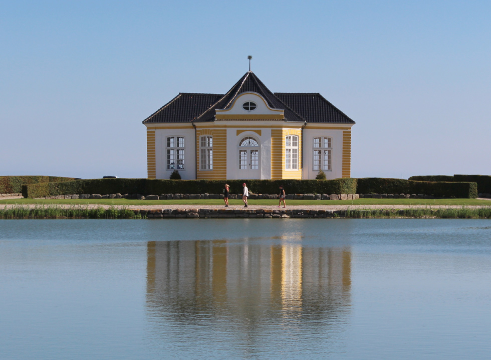 One of the small annexes reflects in the lake by the castle Valdemars Slot, near Vemmenæs