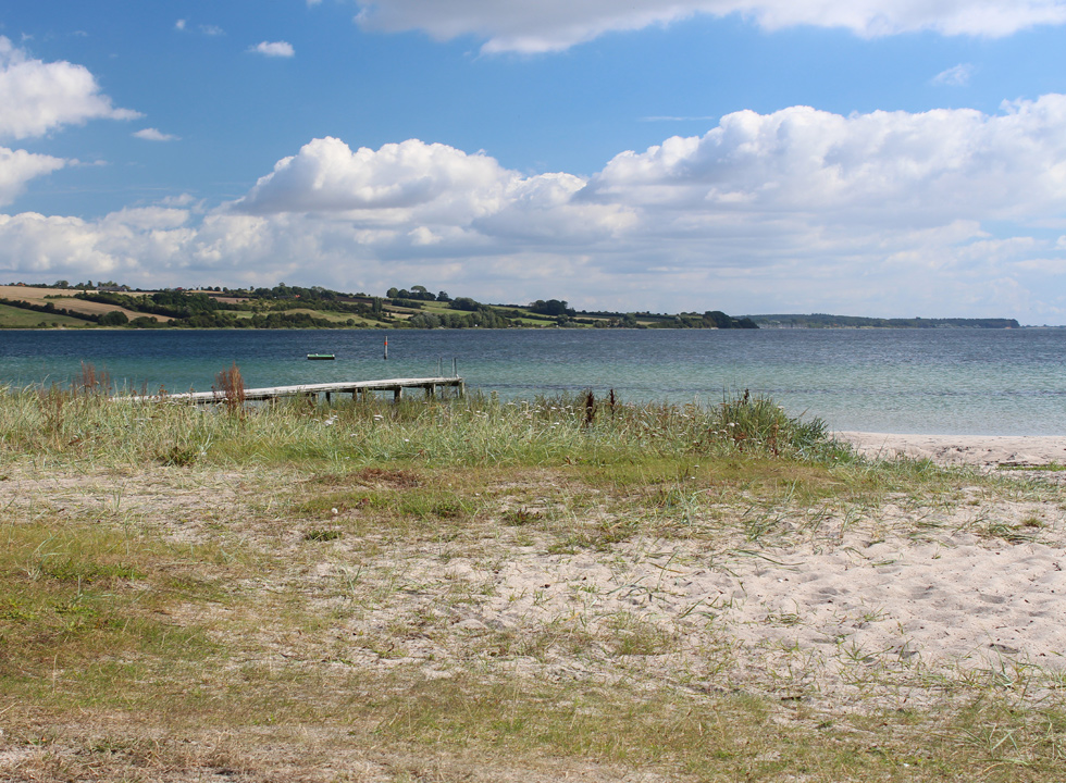 The holiday home area Vemmingbund is situated in a bay in the southernmost part of Denmark