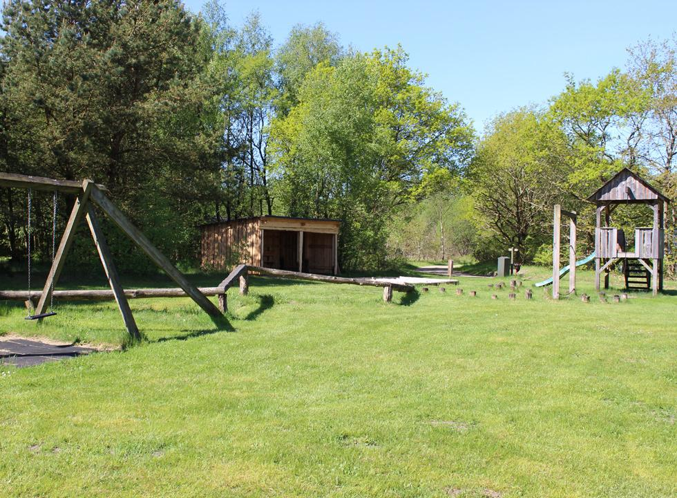 Nature playground on a shared lawn between the holiday homes in Vesterlund