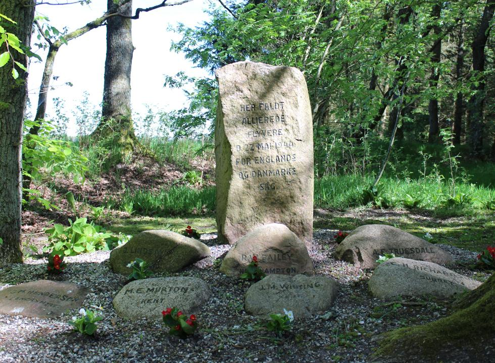Shared and individual monuments for the Allies in the forest behind the holiday homes in Vesterlund