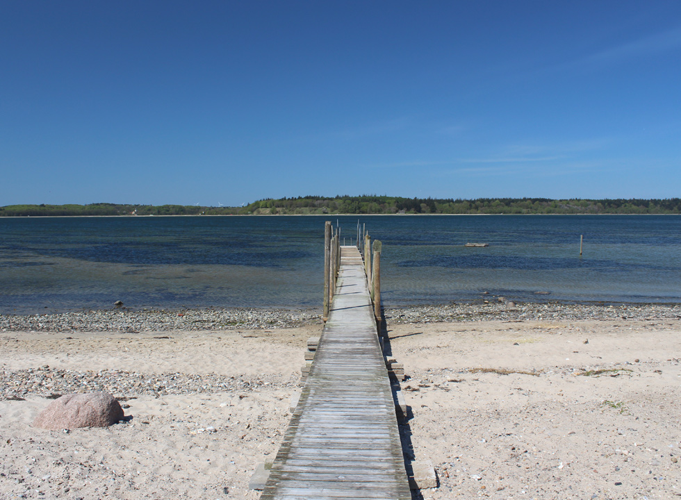 The long bathing jetty leads you across the beach and far out in the water in Vile