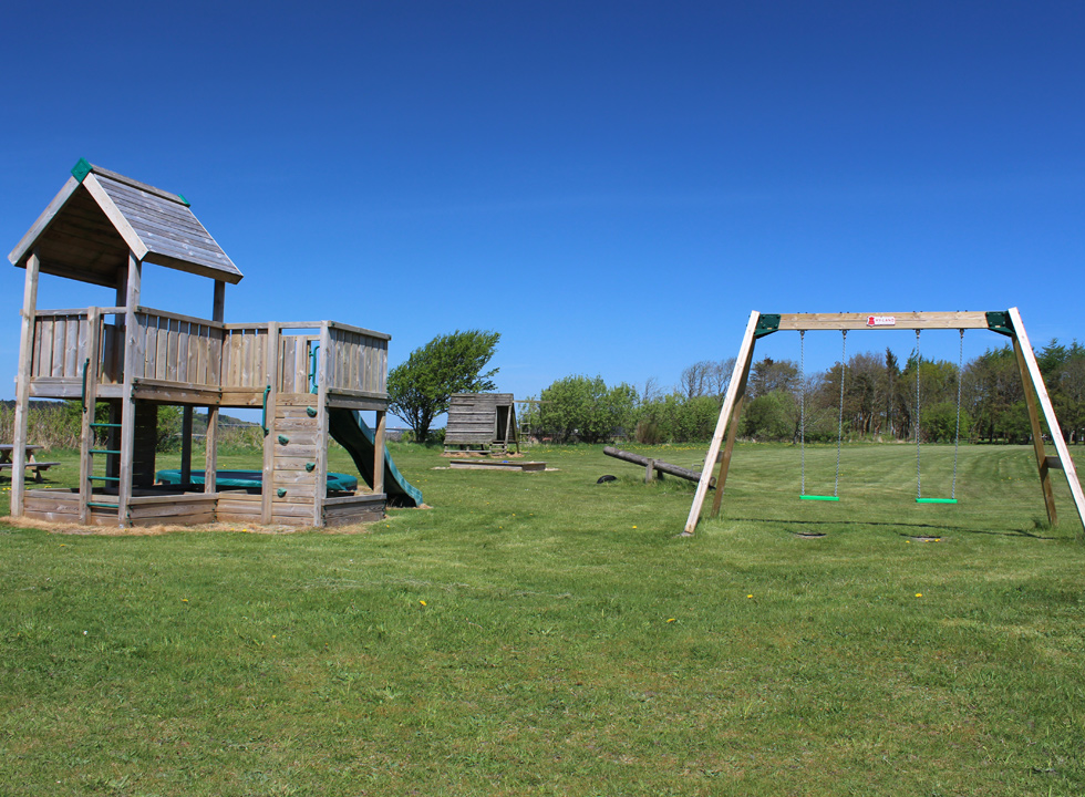 Playground on a large green space between the holiday homes in Vile