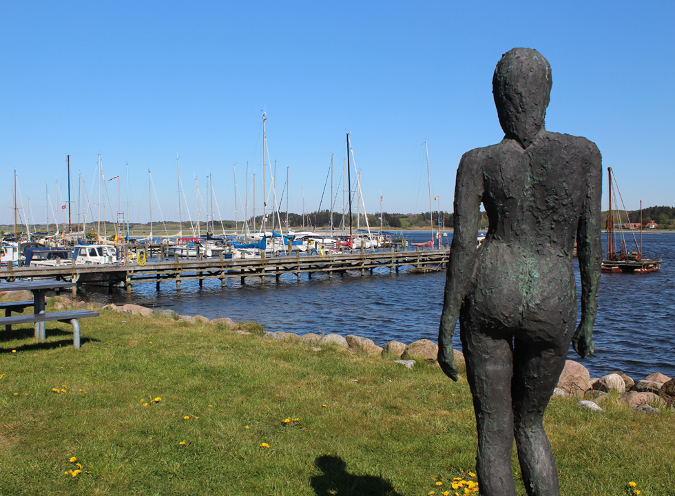 One of the Salling girls watches the harbour in the holiday home area Virksund