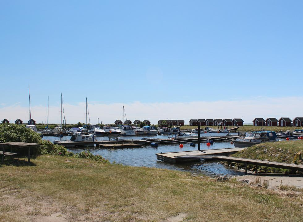 Cosy harbour with leisure boats and small cabins in the holiday area Voerså
