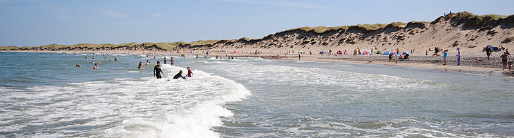 The long bathing beach with high dunes and lovely water in Vorupor