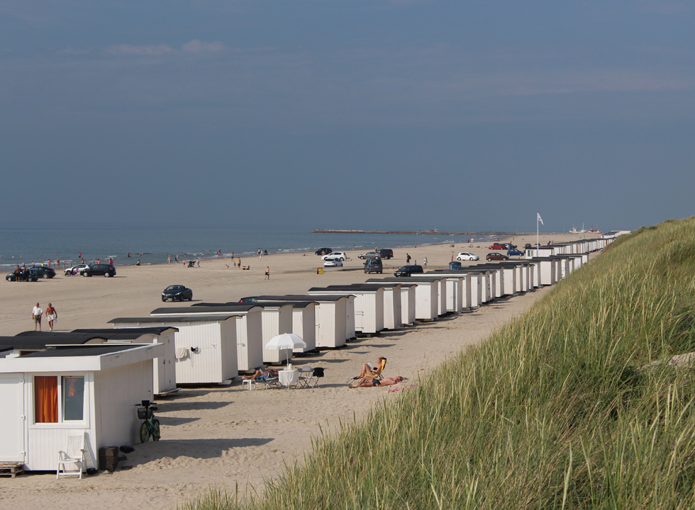 White beach houses on the beach in the holiday town Løkken, just 5 kilometres from Vrensted